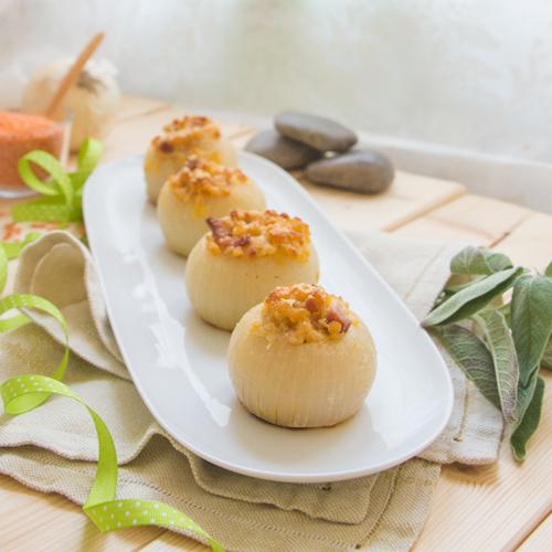 La ricetta light delle cipolle ripiene con lenticchie senza glutine.