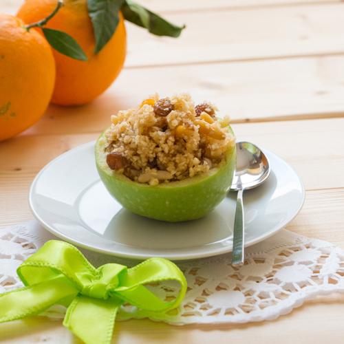 La ricetta light e senza glutine delle mele ripiene con miele, frutta secca e canditi.