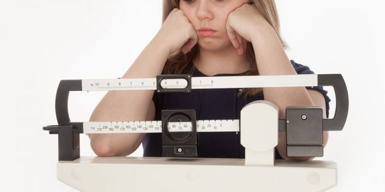 bilancia grassi o zuccheri